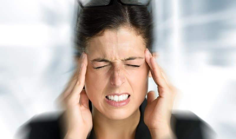 woman with severe headache