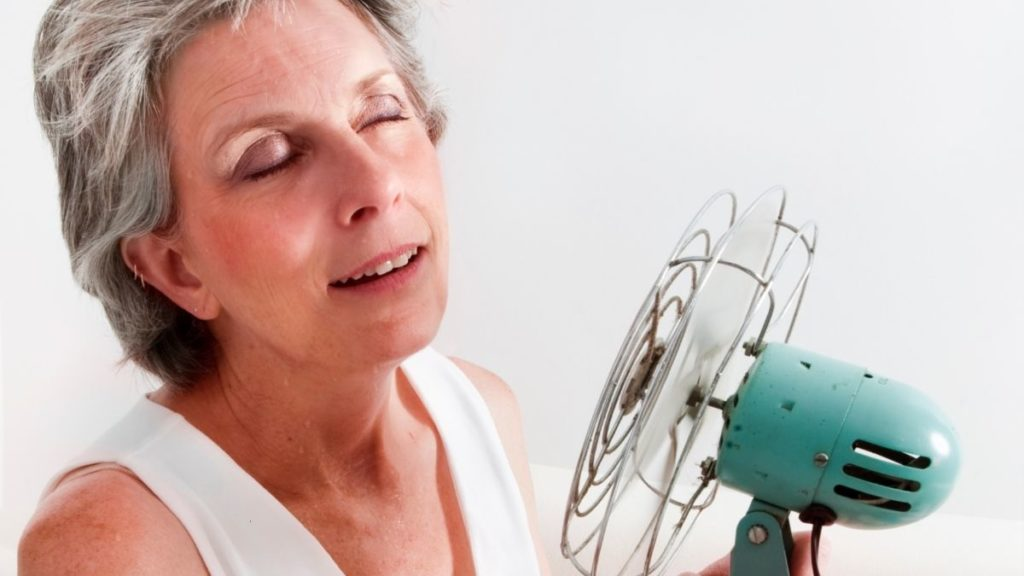 women with fan for menopause